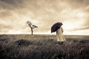 PHQ9 Mental Health Counselling test for Depression - subdued image of man with umbrella