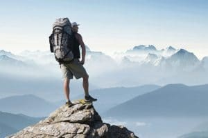 Life Coaching & Psychotherapy Wolverhampton - Man on top of mountain