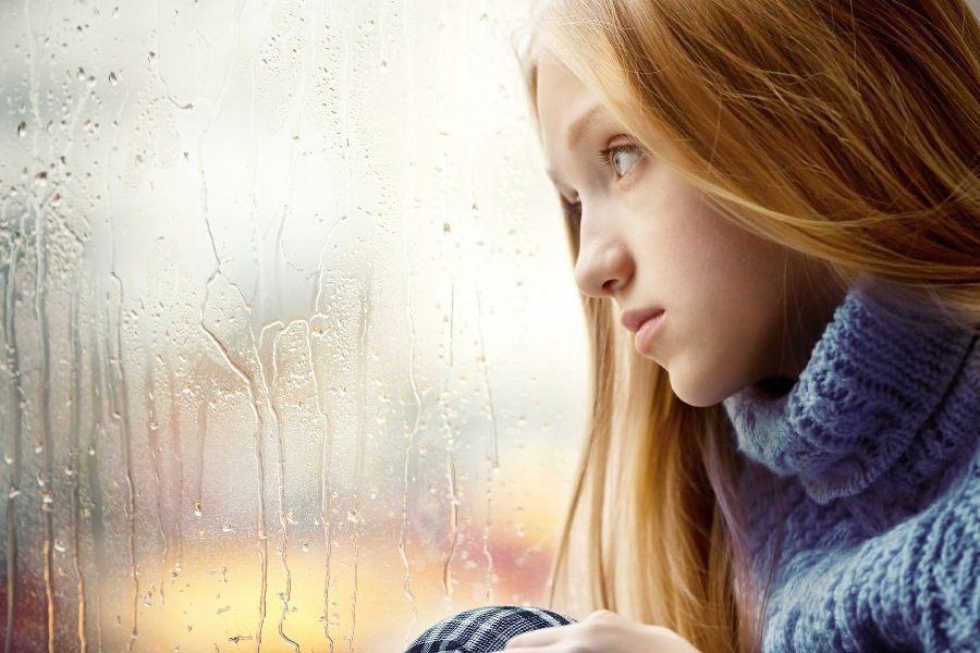 seasonal affective disorder counselling wolverhampton - woman staring out of rain wet window