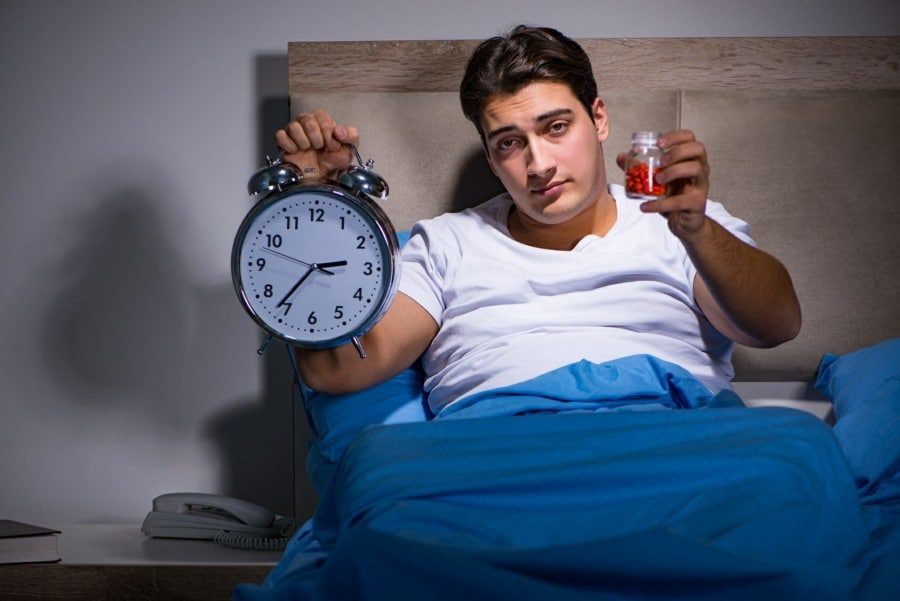sleep disorders counselling wolverhampton - man awake in the early hours