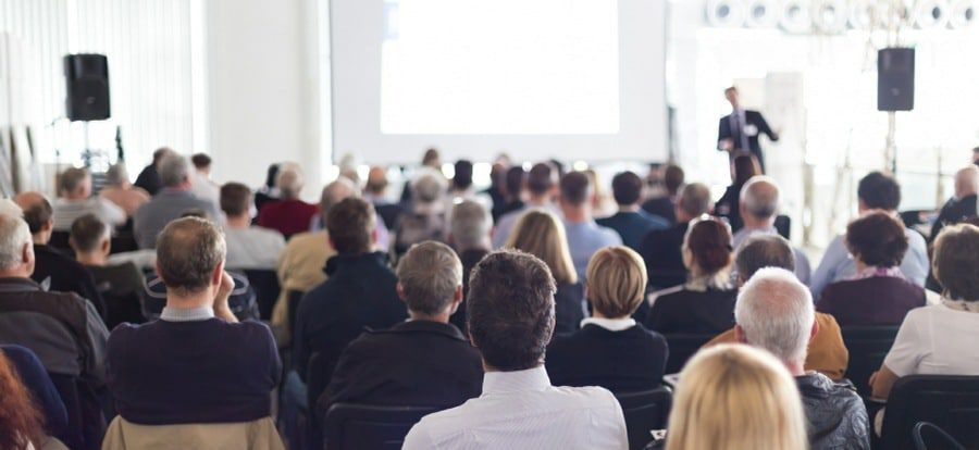 fear of public speaking counselling wolverhampton - man making presentation to large crowd