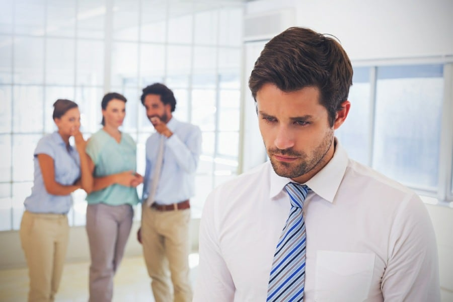 Gelotophobia Fear of Being Laughed At - Work mates laughing at man