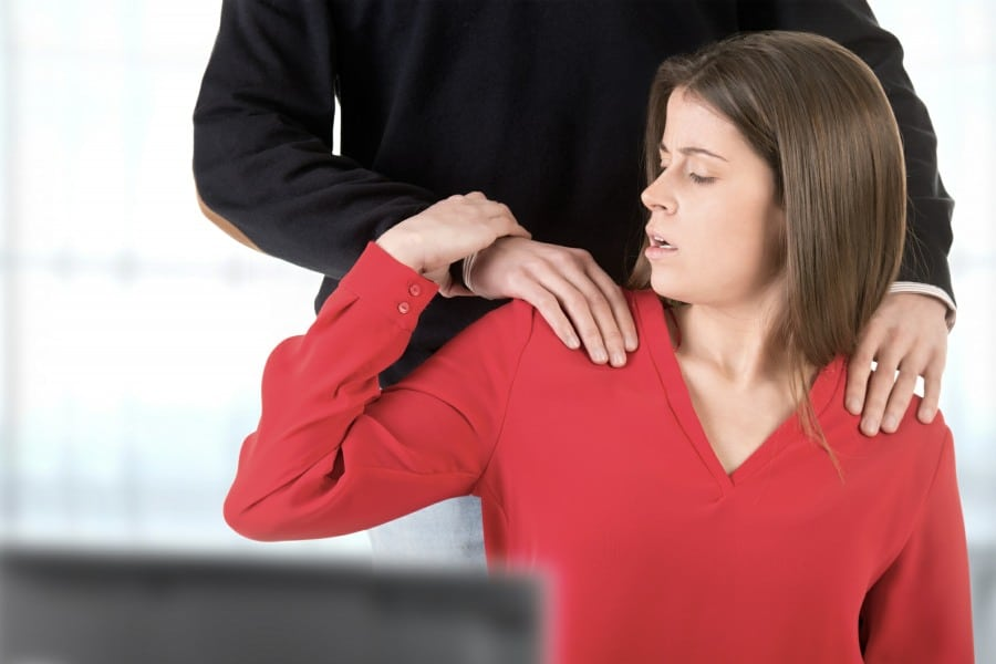 fear of being touched haphephobia - woman looking uncomfortable being touched on shoulders