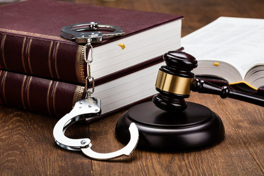 kleptophobia fear of stealing - court room gavel and handcuffs on table