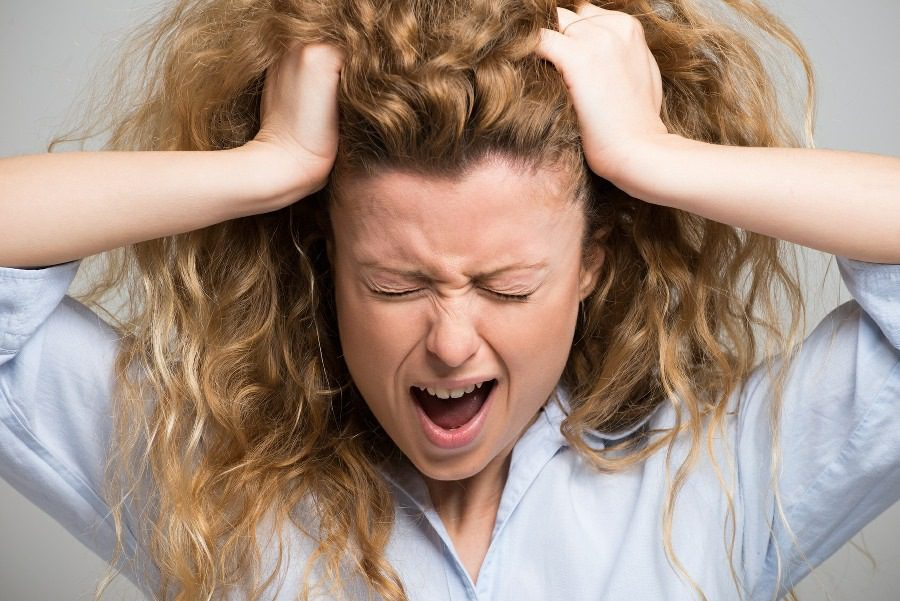 panphobia fear of everything - woman 'pulling her hair out' with fear