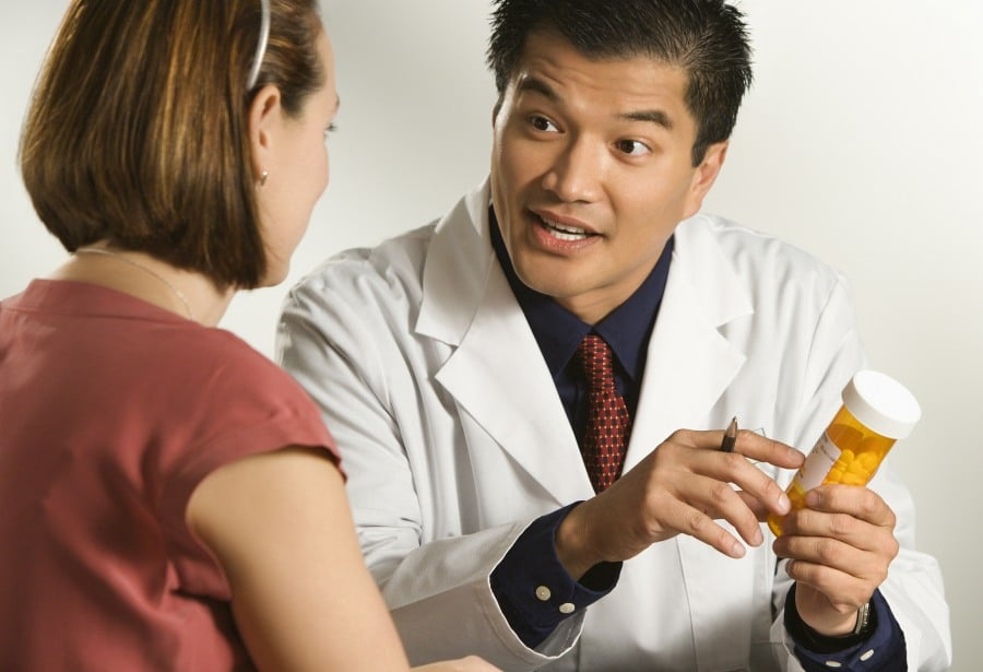 Fear of Medication Pharmacophobia - doctor offering patient medication