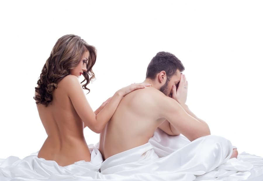 premature ejaculation counselling wolverhampton - woman consoling man in bed after problems