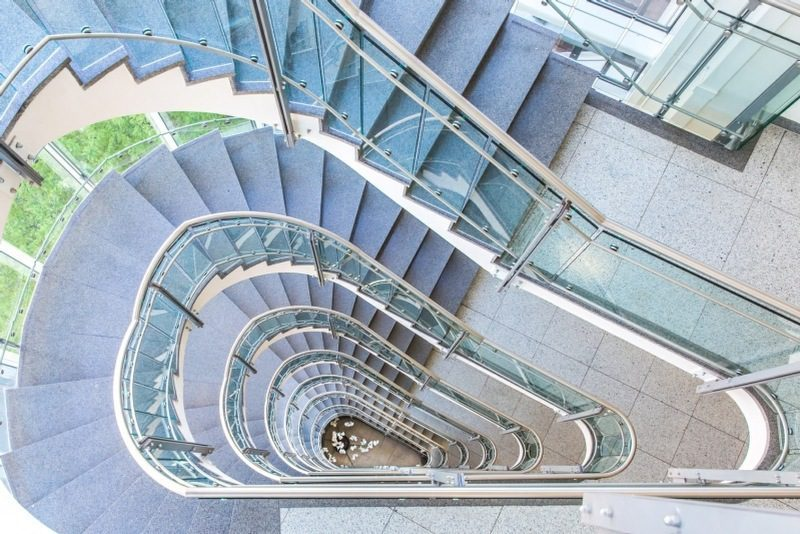 bathmophobia is the fear of stairs - spiral staircase in an office building