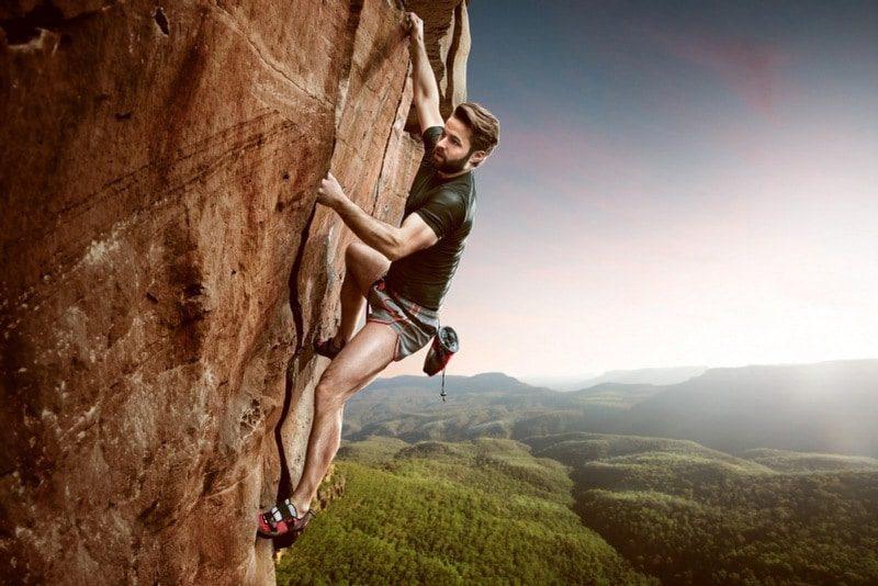 fear of climbing climacphobia - man climbing vertical overhang