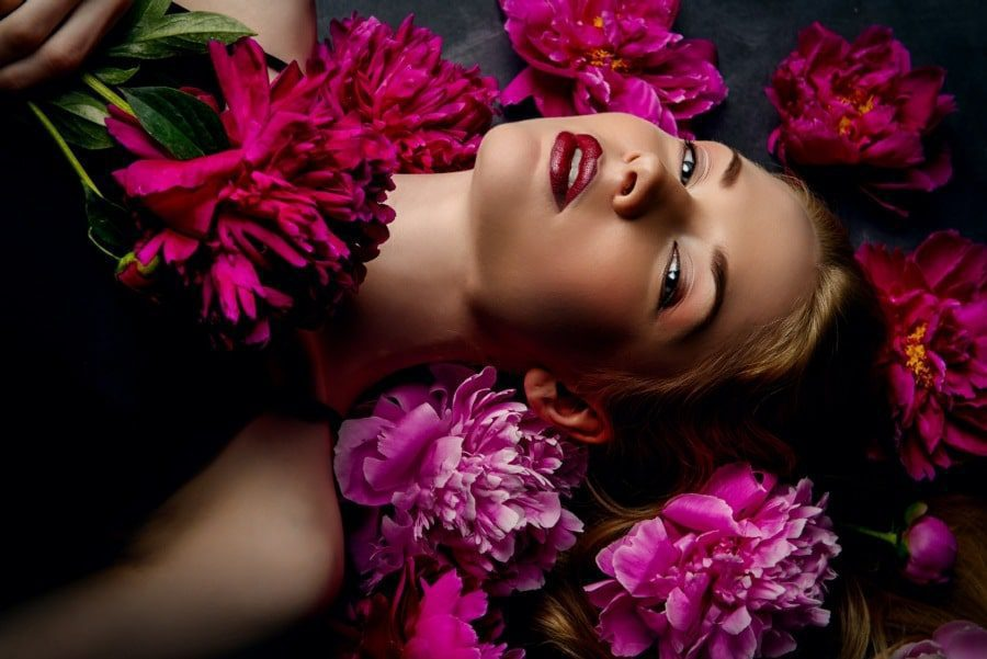 sexual perversions counselling wolverhampton - sexy woman lying in bed of flowers