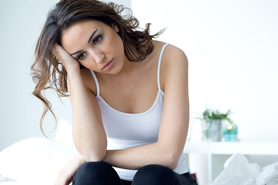 Fear of Being Alone Autophobia - sad woman on side of bed
