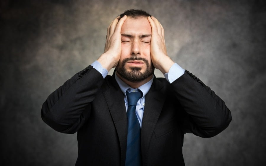 imperative thinking errors lead directly to stress and anxiety - man holding his head