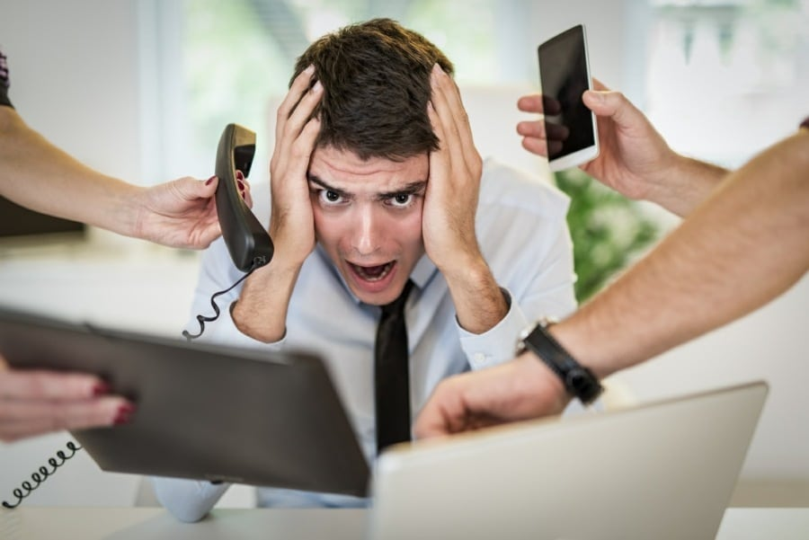 work related stress - tranceform psychology wolverhampton - man under extreme pressure at work