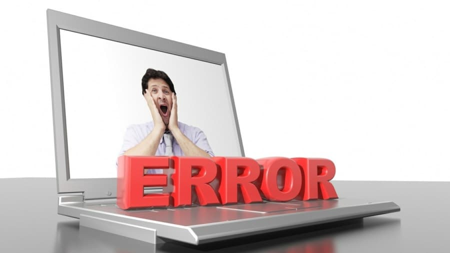 overgeneralising thinking errors and problems - mans face on computer next to the words ERROR