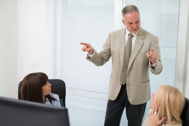 workers catastrophising about being fired for being late - angry manager shouting at staff