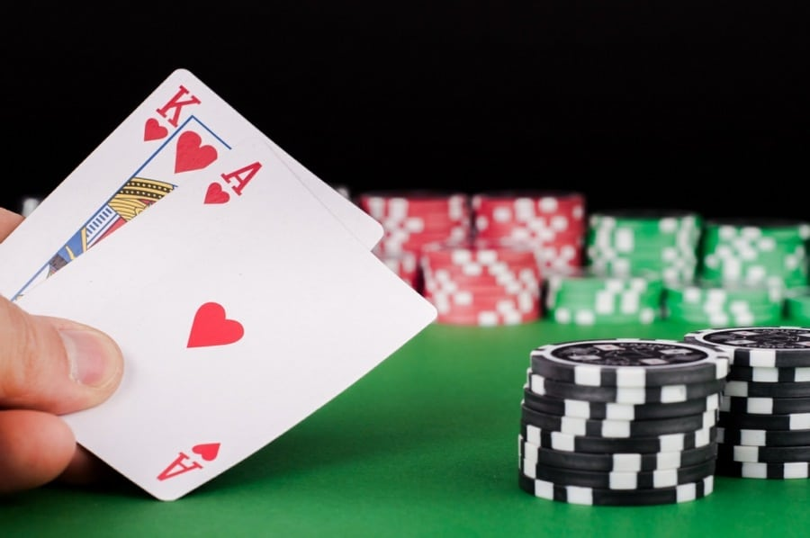 gambling addiction counselling wolverhampton - man with a winning hand of cards and betting chips