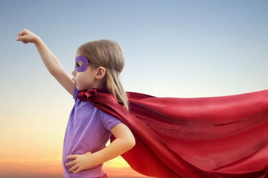 child counselling wolverhampton - young girl imagining she is a super-hero