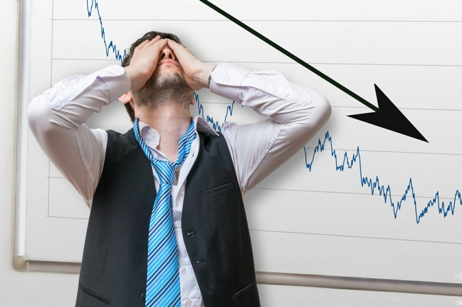 Fear of Failure Atelophobia - man next to disastrous sales results chart