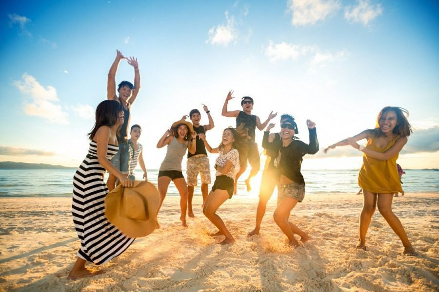 mental health counselling leads to happier lives - happy people on the beach