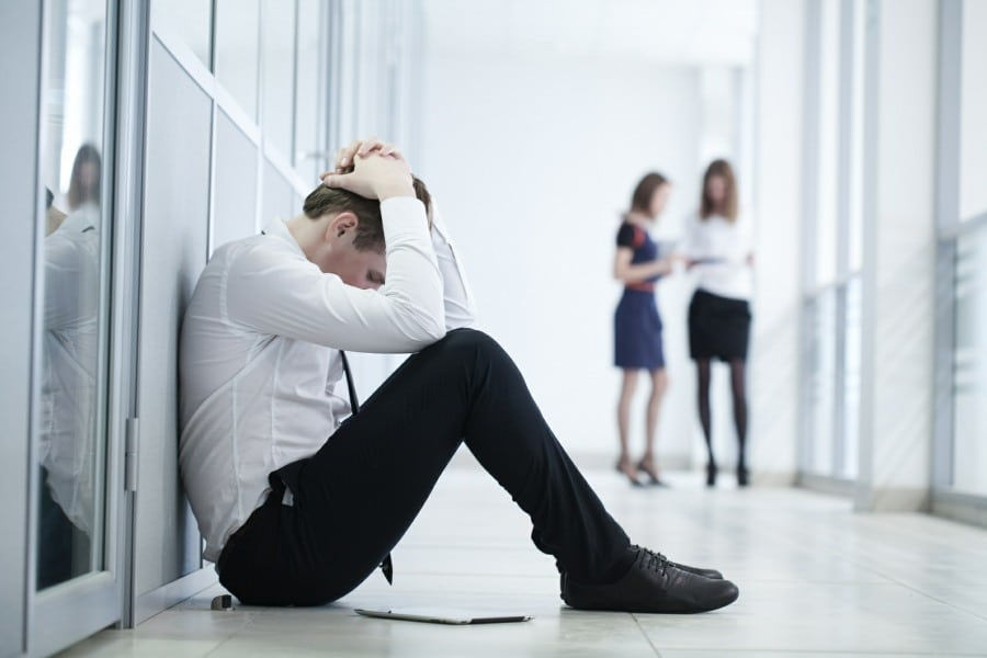 Man suffering mental health problem at work