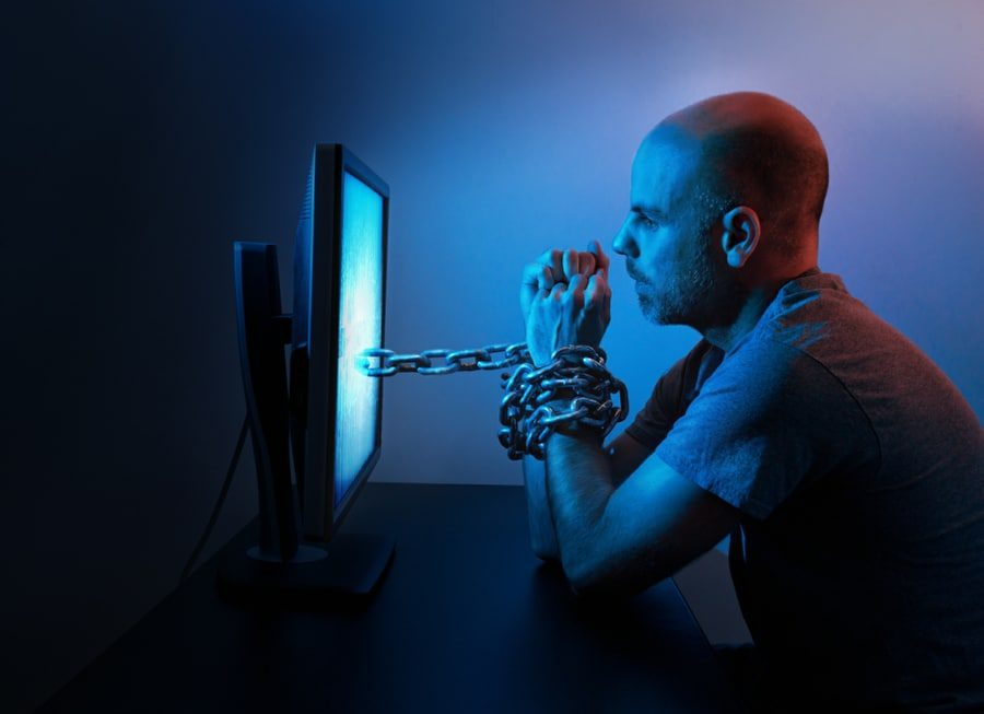 Man with porn addiction chained to computer